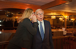 Warren Buffett poses with business students from universities around the country after at lunch at Piccolo Pete's Restaurant in Omaha, Neb., Nov. 11, 2011. Here, Buffett poses with Masha Dudelzak, 27, second-year M.B.A. student at the University of Toronto.