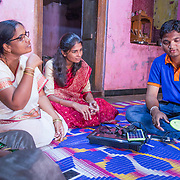 INDIVIDUAL(S) PHOTOGRAPHED: From left to right: Archoma Saresh Lohag, Asha Anil Kamble, Mangal Lohar and Vaibhov Patil. LOCATION: Patan, Satara District, Maharasthra, India. CAPTION: Vaibhov, a Dharma Life employee, provides training to a group of female micro-entrepreneurs on various products, such as the portable solar-powered lamp pictured. In addition to addressing social and environmental issues in their community through the sale of high-impact products, the entrepreneurs themselves are able to gain knowledge and new skills, and generate a sustainable source of income.