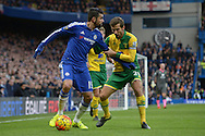 Diego Costa of Chelsea blocking the ball from Gary O'Neil of Norwich City. Barclays Premier league match, Chelsea v Norwich city at Stamford Bridge in London on Saturday 21st November 2015.<br /> pic by John Patrick Fletcher, Andrew Orchard sports photography.