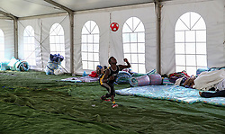 """South Africa - Durban - 28 March 2019 - Police and officials have have movved refugees to Sherwood Hall on Tuesday afternoon to house foreign nationals who were displaced during a """"xenophobic attack"""" at a Durban informal settlement. Fifty people including five babies fled to the Sydenham police station when their unemployed neighbours in the Burnwood informal settlement kicked down their doors at 2am. Picture: Leon Lestrade/African News Agency(ANA)."""