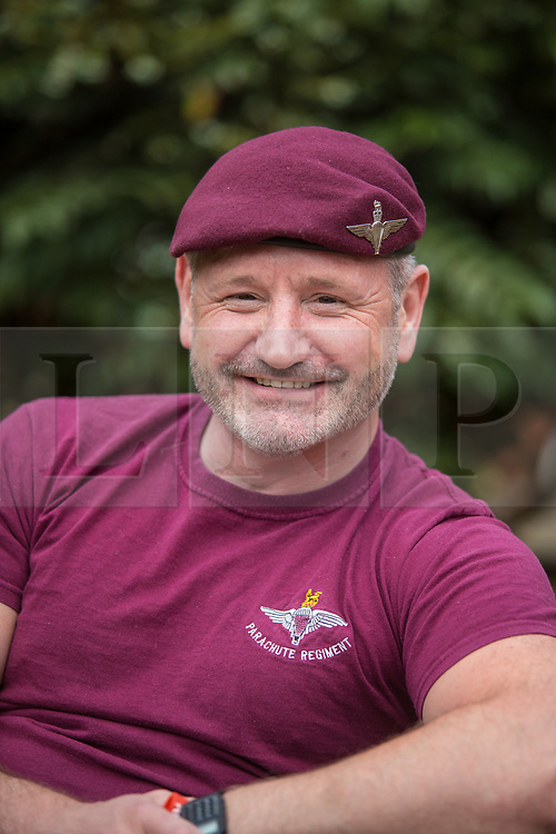 @Licensed to London News Pictures 08/05/2020. Maidstone, UK.. Former paratrooper from 2 Para, Russell Dean, 43 pays tribute to VE75 Day at Queen Elizabeth Court in the Royal British Legion village in Aylesford, Kent. RBLI also wanted to use Two Minute Silence to honour the service and sacrifice of the Second World War generation and reflect on the devastating impact Covid-19 has had on so many lives across the world.  Photo credit: Manu Palomeque/LNP