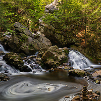 Spring swirl at Bear's Den Falls in New Salem, Massachusetts, Franklin County. This beautiful waterfall is tugged away in western Massachusetts not far away from Quabbin Reservoir.  It is a cascade type waterfall with a beautiful pool at the bottom of the falls surrounded by steep cliffs. I love stepping into this amphitheater of Mother Nature and the feel of an isolation at this scenic waterfall.     <br />