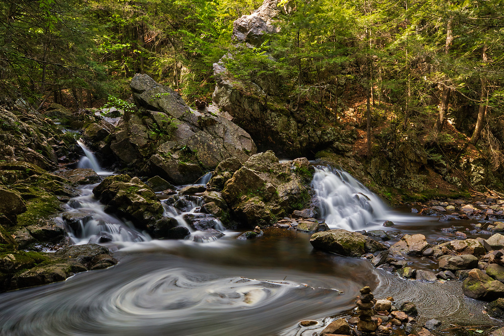 Spring swirl at Bear's Den Falls in New Salem, Massachusetts, Franklin County. This beautiful waterfall is tugged away in western Massachusetts not far away from Quabbin Reservoir.  It is a cascade type waterfall with a beautiful pool at the bottom of the falls surrounded by steep cliffs. I love stepping into this amphitheater of Mother Nature and the feel of an isolation at this scenic waterfall.     <br /> <br /> Central Massachusetts Bear's Den waterfalls photography images are available as museum quality photography prints, canvas prints, acrylic prints or metal prints. Prints may be framed and matted to the individual liking and decorating needs at:<br /> <br /> https://juergen-roth.pixels.com/featured/bears-den-waterfalls-juergen-roth.html<br /> <br /> All high resolution New England photography images from around all six states are available for photo image licensing at www.RothGalleries.com. Please contact me direct with any questions or request. <br /> <br /> Good light and happy photo making!<br /> <br /> My best,<br /> <br /> Juergen<br /> Prints & Licensing: http://www.rothgalleries.com<br /> Photo Blog: http://whereintheworldisjuergen.blogspot.com<br /> Instagram: https://www.instagram.com/rothgalleries<br /> Twitter: https://twitter.com/naturefineart<br /> Facebook: https://www.facebook.com/naturefineart