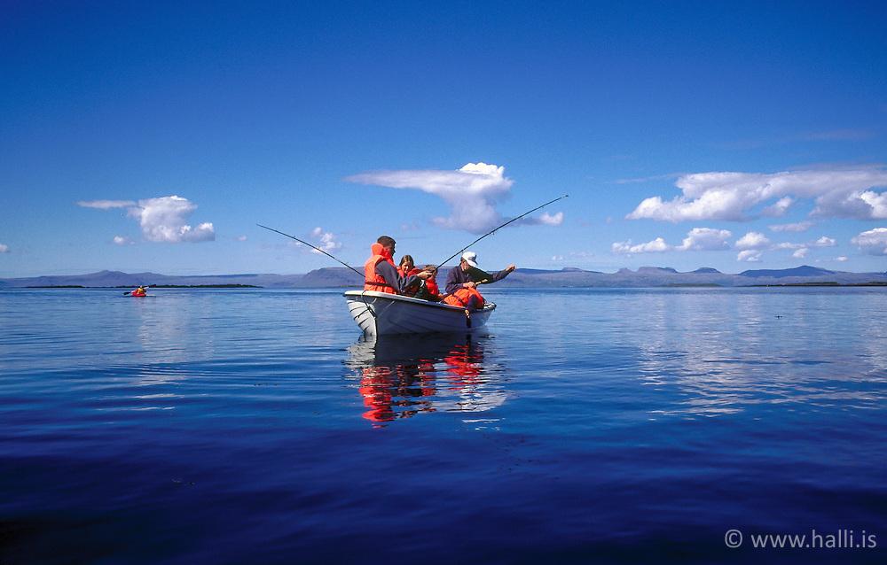 Family fishing from a boat at Flatey in Breidafjordur, Iceland - Fjölskylda að veiða við Flatey á Breiðafirði
