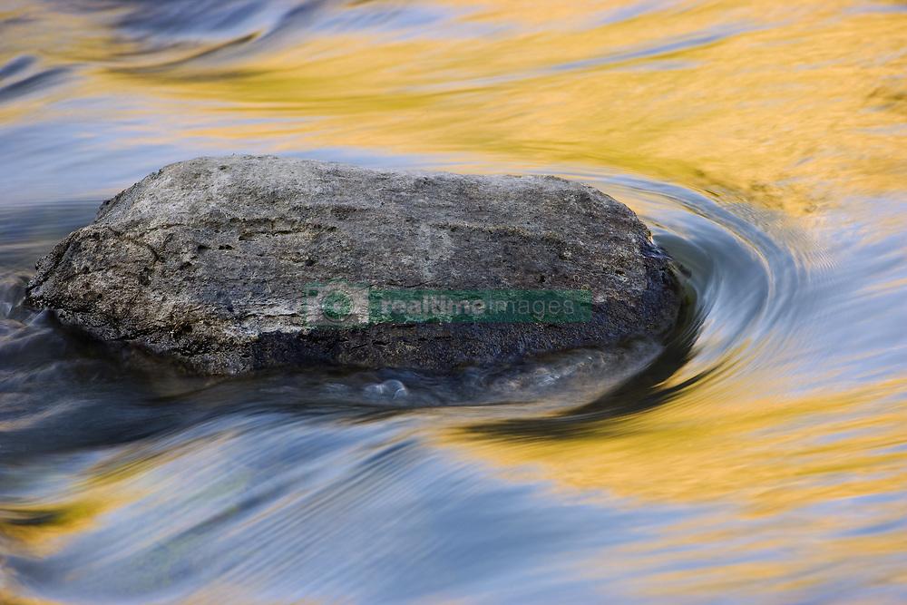 July 21, 2019 - Stone In Moving Water (Credit Image: © Carson Ganci/Design Pics via ZUMA Wire)