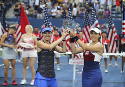 NEW YORK, Sept. 11, 2017  Yung-Jan Chan (R) of Chinese Taipei and Martina Hingis of Switzerland hold the trophy during the awarding ceremony of the women's doubles match at the 2017 US Open in New York, the United States, Sept. 10, 2017. Yung-Jan Chan and Martina Hingis beat Lucie Hradecka and Katerina Siniakova of the Czech Republic 2-0 in the final match to claim the title. (Credit Image: © Wang Ying/Xinhua via ZUMA Wire)