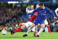10 January 2018 - Football League Cup - Chelsea v Arsenal - Shkodran Mustafi of Arsenal beats Eden Hazard of Chelsea to the ball - Photo: Charlotte Wilson / Offside