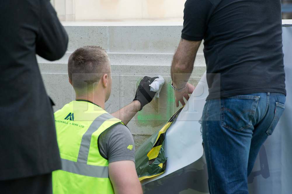"© London News Pictures. 05/06/2013. London, UK. Repair work being carried out on the The RAF Bomber Command Memorial in London's Green Park which has been vandalised for a second time. The letter LE can be read in green paint, possibly the start of the words Lee Rigby. Last week the word ""Islam"" was sprayed onto the memorial in the aftermath of the killing of Drummer Lee Rigby in Woolwich.. Photo credit: Ben Cawthra/LNP"
