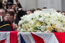 © Licensed to London News Pictures . 17/04/2013 . London , UK . Baroness Thatcher's coffin passes through Ludgate Circus . The funeral of former British Conservative Prime Minister , Baroness Margaret Thatcher , today (Wednesday 17th April 2013) in Central London . Baroness Thatcher died from a stroke at the age of 87 . Photo credit : Joel Goodman/LNP