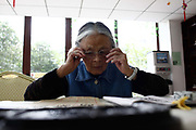 A resident practices traditional Chinese calligraphy at the Cherish-Yearn retirement community on the outskirts of Shanghai, China, on Tuesday, Dec. 13, 2011. China has about  36000 institutions and 2.7 million beds serving the elderly, enough for 1.6 percent of the population over 60, according to the World Bank.