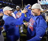 CHICAGO, IL - OCTOBER 22: Eric Hinsek and David Ross celebrate during the post game celebration on the field after the Cubs defeated the Los Angeles Dodgers in Game 6 of the NLCS at Wrigley Field on Saturday, October 22, 2016 in Chicago, Illinois. (Photo by Ron Vesely/MLB Photos via Getty Images)