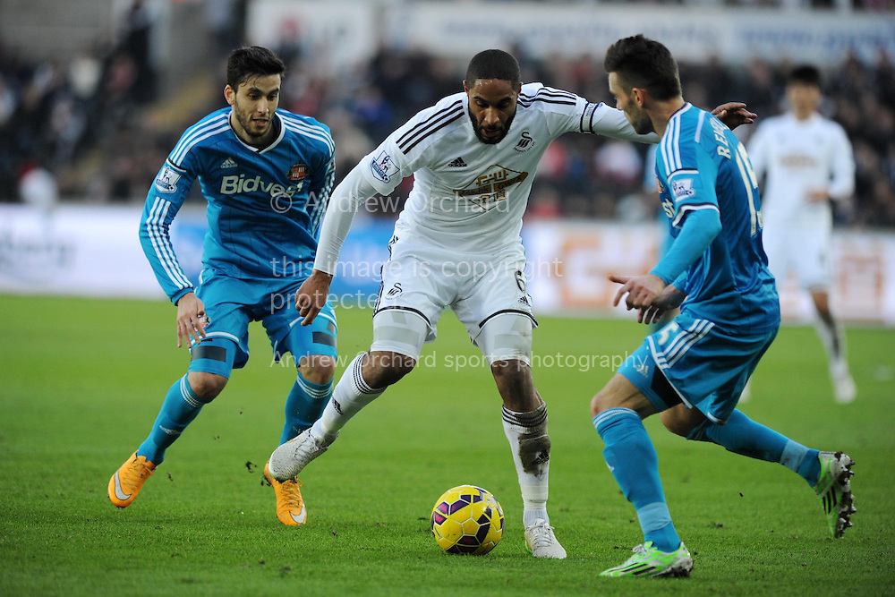 Ashley Williams of Swansea city (c)  in action.   Barclays premier league match, Swansea city v Sunderland at the Liberty stadium in Swansea, South Wales on Saturday 7th Feb 2015.<br /> pic by Andrew Orchard, Andrew Orchard sports photography.
