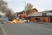 Loyalists set up a burning barricade on Lanark Way in West Belfast, Northern Ireland on Monday, April 19, 2021. Loyalist protest over the Brexit Northern Ireland Protocol has resumed across various locations in the British province. (Photo/ Vudi Xhymshiti)