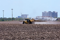 12 May 2009: A farm service sprays chemicals on a field preparing it for planting.