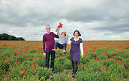 Family in a field of poppies by Kristina Cilia Photography of Vacaville