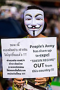 """04 AUGUST 2013 - BANGKOK, THAILAND:  A """"White Mask"""" anti-government protestor in Bangkok Sunday. About 2,000 people, members of the  People's Army against Thaksin Regime, a new anti-government group, protested in Lumpini Park in central Bangkok. The protest was peaceful but more militant protests are expected later in the week when the Parliament is expected to debate an amnesty bill which could allow Thaksin Shinawatra, the exiled former Prime Minister, to return to Thailand.     PHOTO BY JACK KURTZ"""