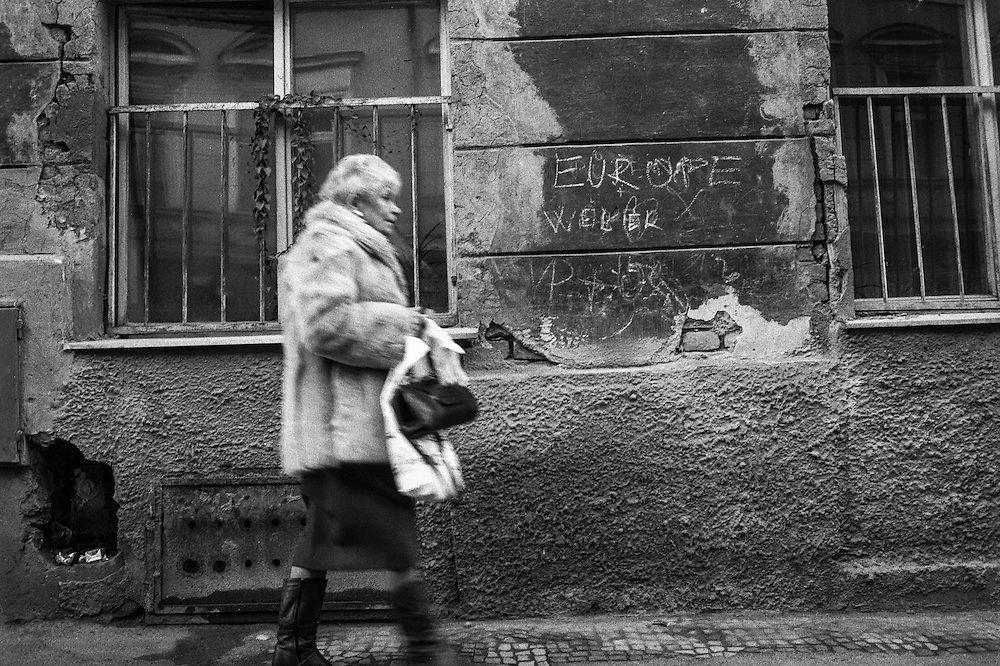 Woman with a fur coat walking the street of Zizkov.