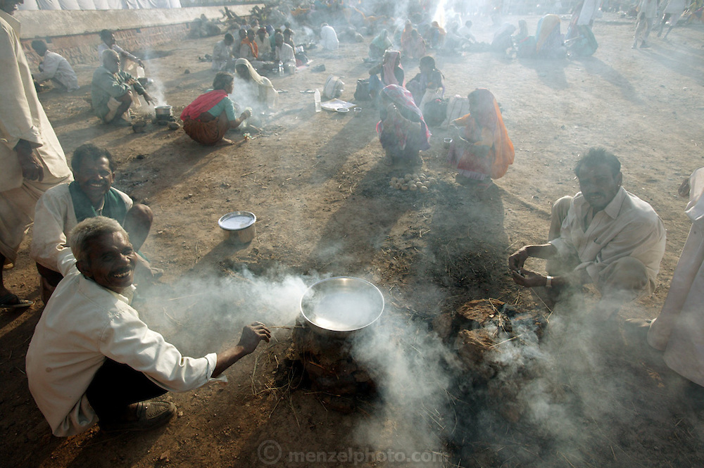 Hindu pilgrims cook simple meals of fried dough balls during the Kumbh Mela festival in Ujjain, India. (Supporting image from the project Hungry Planet: What the World Eats).