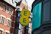 Sign for the mobile phone and telephone service provider brand EE in Birmingham, United Kingdom.