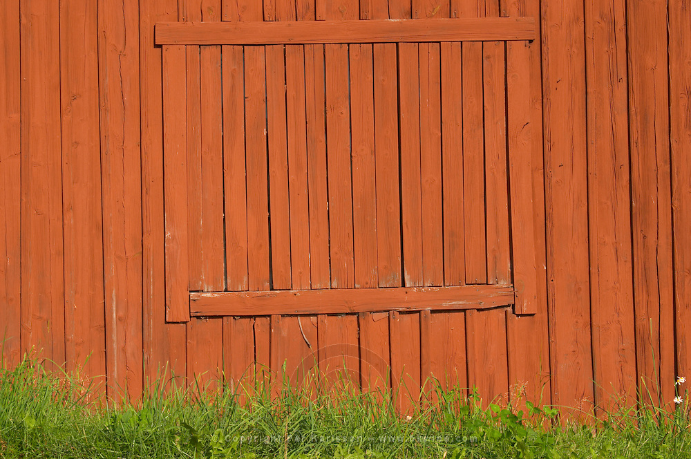 Traditional style Swedish wooden painted house. Window Boarded up. Smaland region. Sweden, Europe.