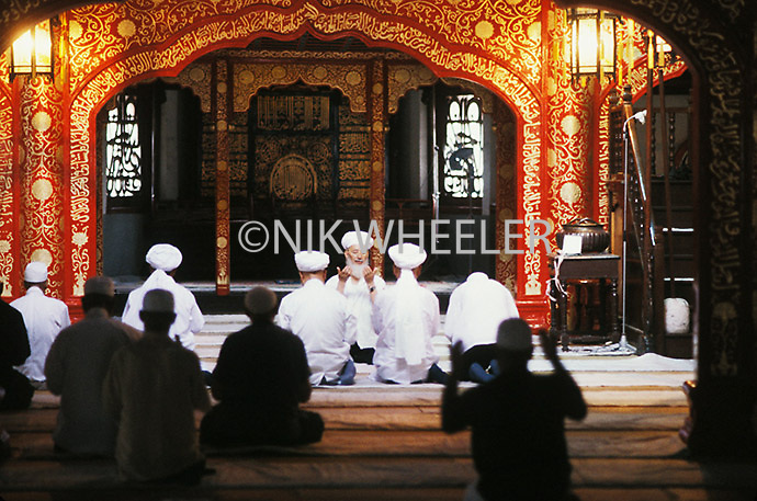 Friday noon prayers at the Niujie Mosque in the Muslim quarter of Beijing, China