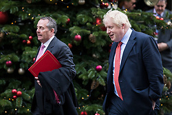 © Licensed to London News Pictures. 19/12/2017. London, UK. Secretary of State for International Trade Liam Fox (L) and Foreign Secretary Boris Johnson (R) leave 10 Downing Street after the weekly Cabinet meeting. Photo credit: Rob Pinney/LNP