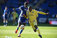 Millwall's Ricardo Fuller  ®  holds off Cardiff's Bruno Ecuele-Manga.  Skybet football league championship, Cardiff city v Millwall at the Cardiff city stadium in Cardiff, South Wales on Saturday 18th April 2015<br /> pic by Andrew Orchard, Andrew Orchard sports photography.