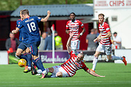 Steven MacLean of Heart of Midlothian is tackled by Darian Mackinnon of Hamilton Academical FC during the Ladbrokes Scottish Premiership League match between Hamilton Academical FC and Heart of Midlothian FC at New Douglas Park, Hamilton, Scotland on 4 August 2018. Picture by Malcolm Mackenzie.