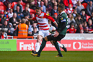 Matty Blair of Doncaster Rovers (17) passes the ball during the EFL Sky Bet League 1 match between Doncaster Rovers and Plymouth Argyle at the Keepmoat Stadium, Doncaster, England on 13 April 2019.