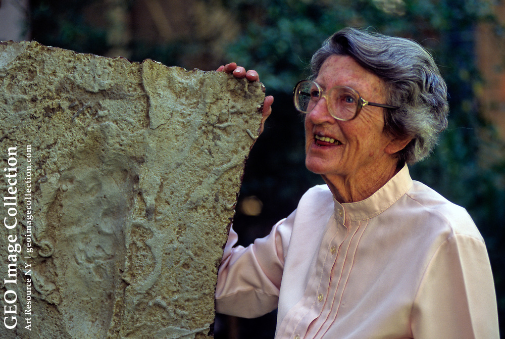 Mary Leakey  with a cast of the first footprints in wet volcanic ash, Tanzania, Africa, Laetoli plain, 3.6 million years ago