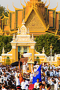 """01 FEBRUARY 2013 - PHNOM PENH, CAMBODIA: The coffin bearing former King Norodom Sihanouk leaves the Royal Palace in Phnom Penh during the funeral procession for the King. Norodom Sihanouk (31 October 1922- 15 October 2012) was the King of Cambodia from 1941 to 1955 and again from 1993 to 2004. He was the effective ruler of Cambodia from 1953 to 1970. After his second abdication in 2004, he was given the honorific of """"The King-Father of Cambodia."""" Sihanouk died in Beijing, China, where he was receiving medical care, on Oct. 15, 2012. His cremation is will be on Feb. 4, 2013. Over a million people are expected to attend the service.    PHOTO BY JACK KURTZ"""
