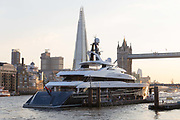The brand new 74.5m long superyacht, Elandess is seen moored at HMS President on the River Thames on July 05, 2018 after making its maiden voyage to London this week. Elandess was built at the Abeking and Rasmussen shipyard in Germany for owner, Lloyd Dorfman, the founder of Travelex, was launched in May 2018 and has just completed sea trials ahead of its London visit. Elandess has an axe-bow, dark hull and low-slung superstructure. There are a variety of entertaining communal spaces, from the 8 x 2.5-metre superyacht swimming poollocated on the massive sun deckto the Nemo Loungewith portholesbelow the waterline and an observation lounge on the upper deck. Guest accommodation includes six staterooms, including the master suitewhich is placed forward on the main deck with an observation lounge directly above on the upper deck.