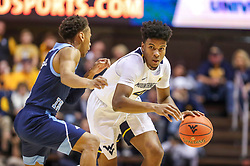 Dec 1, 2019; Morgantown, WV, USA; West Virginia Mountaineers guard Miles McBride (4) dribbles down the court during the second half against the Rhode Island Rams at WVU Coliseum. Mandatory Credit: Ben Queen-USA TODAY Sports