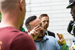 James Goddard argues with police after court officials asked them to intervene when a woman who appeared to be one of his supporters was filming on her smartphone just within the court building as he arrives at Westminster Magistrates Court in London where he is on trial for harassment of MP Anna Soubry outside the Houses of Parliament. LONDON, July 19 2019.