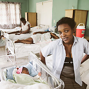 INDIVIDUAL(S) PHOTOGRAPHED: . LOCATION: St. Damien Hospital, Nos Petits Frères et Sœurs, Tabarre 41 Commune, Haïti. CAPTION: Fessiva Lamour, poses with her darling baby Jessica in the maternity ward of St. Damien Hospital.