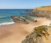 Sandy beach Praia dos Alteirinhos, Zambujeira do Mar in bay between rocky headlands part of Parque Natural do Sudoeste Alentejano e Costa Vicentina, Costa Vicentina and south west Alentejo natural park, Zambujeira do Mar, Alentejo  Littoral, Portugal, southern Europe
