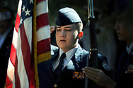 Cadet Glen Gibson, 15, Mayfield High School U.S. Air Force JROTC color guard, salutes the American flag during the Memorial Day ceremony at Hillcrest Memorial Gardens Cemetery.