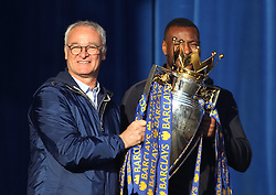 Leicester City Manager Claudio Ranieri (L) and Wes Morgan hold up the trophy to fans at Victoria park during the victory celebrations  - Mandatory by-line: Jack Phillips/JMP - 16/05/2016 - FOOTBALL - Leicester City FC, Sky Bet Premier League Winners 2016 - Leicester City Victory Parade