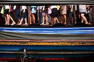 Passengers disembark from a .Khlong Taxi, Bangkok, Thailand