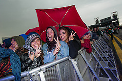 © Licensed to London News Pictures. 30/05/2014. Barcelona, Spain.   Torrential rain doesn't stop festival goers in the front row of the audience enjoying the music at Primavera Sound festival, Barcelona.  Primavera Sound festival, or simply Primavera, is an annual music festival that takes place in Barcelona, Spain in late May/June within the Parc del Fòrum leisure site. Photo credit : Richard Isaac/LNP