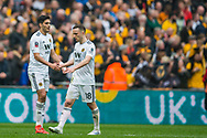 Diogo Jota (Wolverhampton Wanderers) congratulates Raul Jimenez (Wolverhampton Wanderers) on his goal during the FA Cup semi-final match between Watford and Wolverhampton Wanderers at Wembley Stadium in London, England on 7 April 2019.