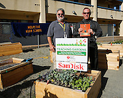 Milpitas High School biology and forensic science teacher Gordon Sanford and principal Ken Schlaff pose for a portrait at the American Heart Association Teaching Garden at Milpitas High School in Milpitas, California, on October 8, 2013. (Stan Olszewski/SOSKIphoto)