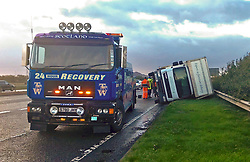 Pictured: <br /> Rescue was on hand the the high-sided delivery lorry on the A1 tonight.  The lorry was blown over on the A1 on the slip road down to join the Edinburgh City Bypass. Police and rescue services will be on high alert as Storm Ali moves across the country.<br /> <br /> <br /> Chris McCluskie| EEm 19 September 2018