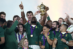 South Africa's Siya Kolisi lifts the Webb Ellis Cup as South Africa celebrate winning the 2019 Rugby World Cup final at Yokohama Stadium.