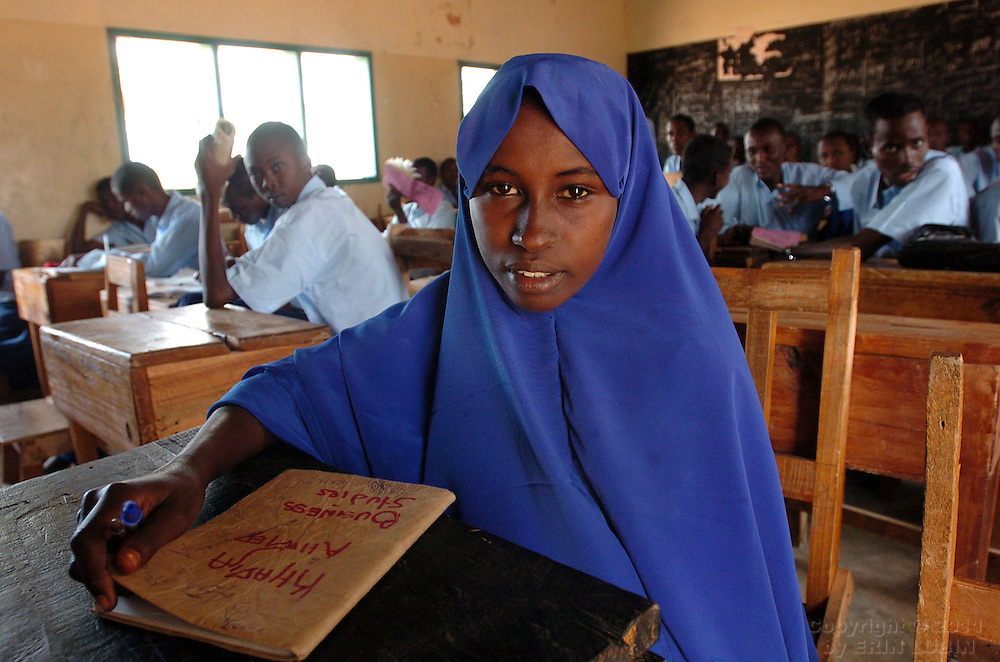 Khadija Ahmed, 16, one of only two girls at  Dadaab Secondary School in Dadaab, Kenya, sits at her desk during class, September 11, 2006. Khadija, a resident of the refugee camp host community in Dadaab, received a scholarship from CARE to attend secondary school which costs $400 a year...Photograph by Erin Lubin