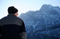 THEMENBILD - Winter Wanderung von Lienz zum Reiter Kirchl welches sich ueber Leisach auf 1130 m Seehoehe befindet, das Bild wurde am 25. Dezember 2011 aufgebommen, im Bild Wanderer mit Spitzkofel in den Lienzer Dolomiten, AUT, EXPA Pictures © 2011, PhotoCredit: EXPA/ M. Gruber