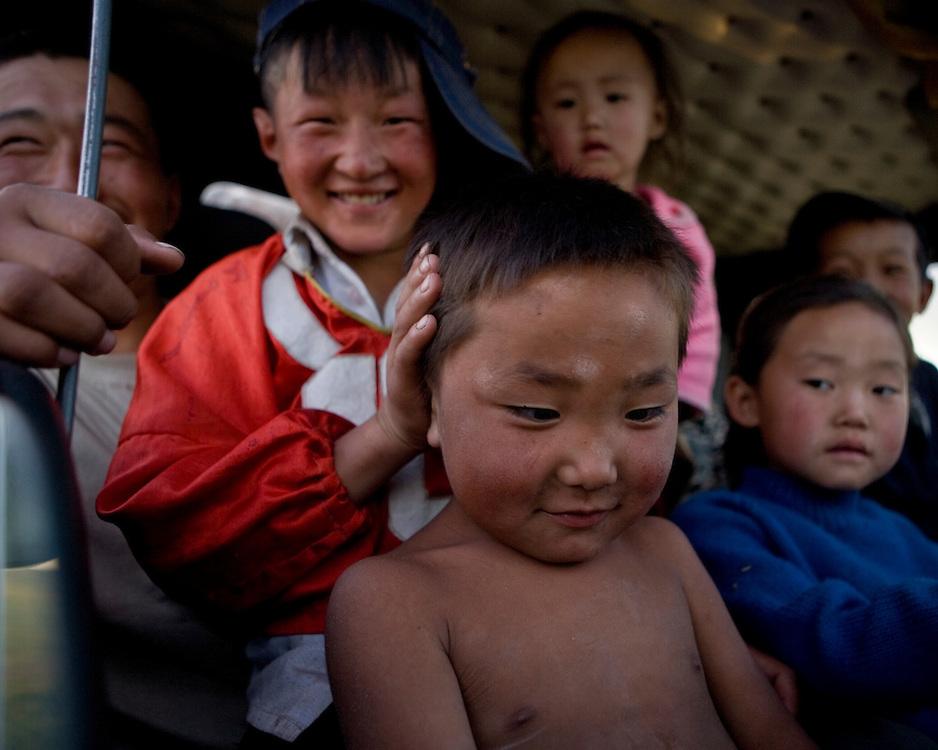 Mongolian kids in a car
