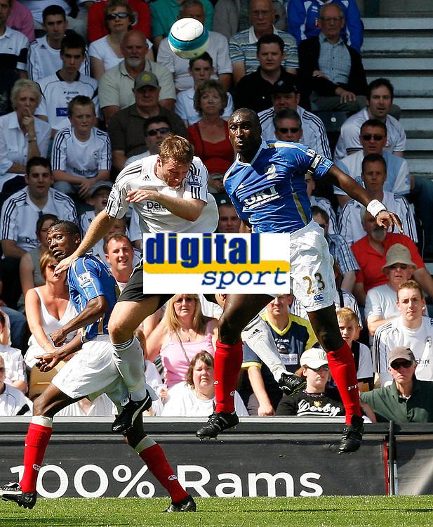 Photo: Steve Bond. <br />Derby County v Portsmouth. Barclays Premiership. 11/08/2007. Sol campbell (R) clears. Steve Howard (L) challanges