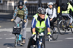 © Licensed to London News Pictures. 04/05/2020. London, UK. Cyclists make their way through Parliament Square in London during the morning commute. Government is set to introduce measure to easy lockdown, which was introduced to fight the spread of the COVID-19 strain of coronavirus. Photo credit: Ben Cawthra/LNP