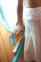 A woman's hand releasing a curtain in a natural light filled room.<br /> :::<br /> As for the body, it is solid and strong and curious<br /> and full of detail: it wants to polish itself; it <br /> wants to love another body; it is the only vessel in <br /> the world that can hold, in a mix of power and <br /> sweetness: words, song, gesture, passion, ideas,<br /> ingenuity, devotion, merriment, vanity, and virtue.<br /> <br /> ~ Mary Oliver